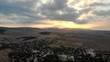 Beautiful sunrise above Bulgarian village in summer, Aerial view.