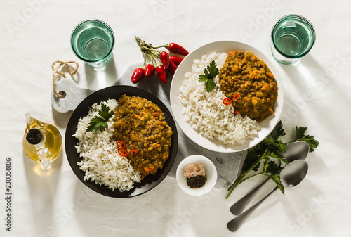 Fényképezés  Basmati rice with curry from vegetables and lentils