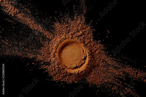 pile cocoa powder pile  on black background, top view