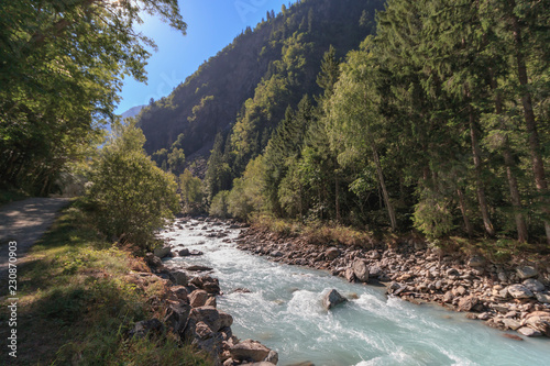 Mountain river in France Alps at summer time