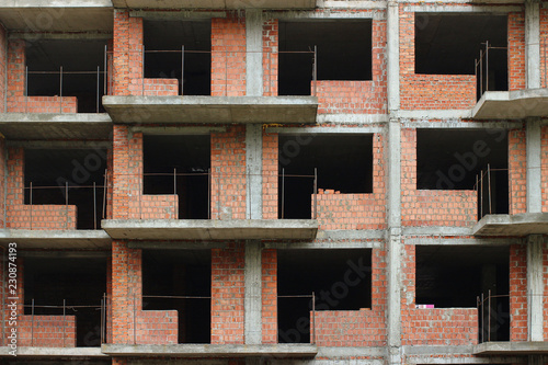 Photographie A tall house is being built close up