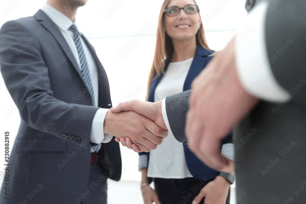 Fototapeta Business shaking hands in the office