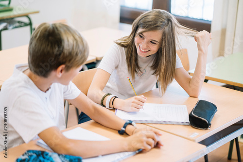 Fotografie, Obraz  Couple young students studying at school