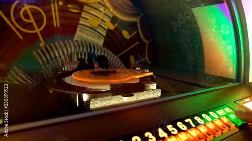 Fotografía  Retro music box, bar customer choosing favorite melody, entertainment nostalgia