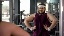 Funny Obese Man Looking At Mirror Reflection And Posing Like Macho, Motivation