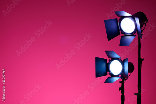 Equipment for photo studios and fashion photography. Pink background and reflector. Ready to shoot photo scheme concept.