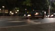 Blurred scene of cars passing by in a low traffic street in Guayaquil, Ecuador. Car lights and street lights can be seen.