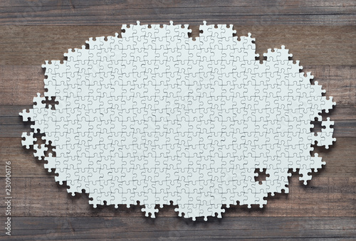 Fotografie, Obraz  Blank jigsaw puzzle missing pieces to finish