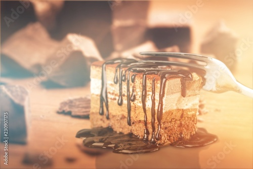 Tasty tiramisu cake on background