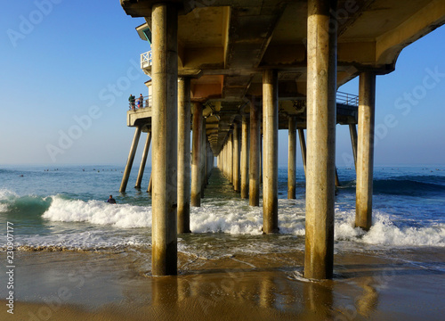 underneath ocean pier with waves crashing