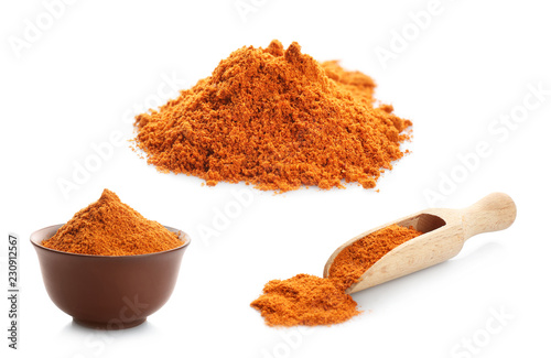 Set with red pepper powder on white background