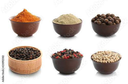 Set with powders and pepper corns on white background