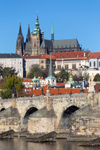 Colorful Autumn Prague Gothic Castle And Charles Bridge With The Lesser Town In The Sunny Day, Czech Republic