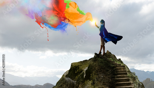 Foto  Super woman in sky. Mixed media