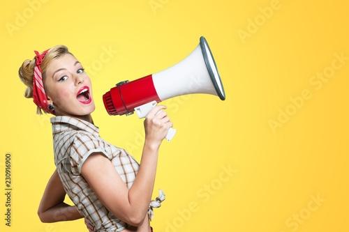 Fotografía  Young beautiful blonde woman with loudspeaker