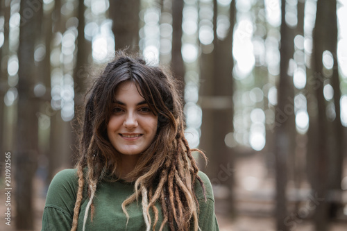 young woman hiker relaxing in the woods