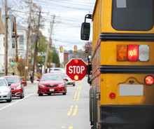 School Bus With Stop Sign Flas...