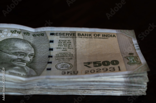Fotografering  A bundle of Rs 500 Indian Currency kept on a table