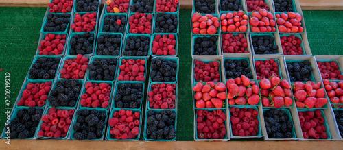 Rasberries, Blackberries, and Strawberries at farmers market in California