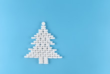 Medicine Pills Shape Of Christmas Tree On Blue Background. Concept Christmas And New Year