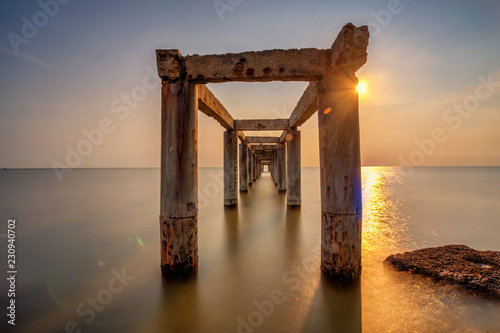 A long Exposure Picture Of abandoned old jetty with cloudy before  burning sunse Wallpaper Mural