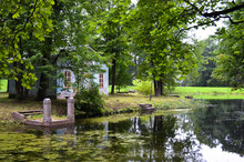 Abandoned Park With A Pond And A Ruined Antique Pavilion. Landscape Garden In Style Of Wild Nature. For Posters, Interior, Prints, Design, Calendar.