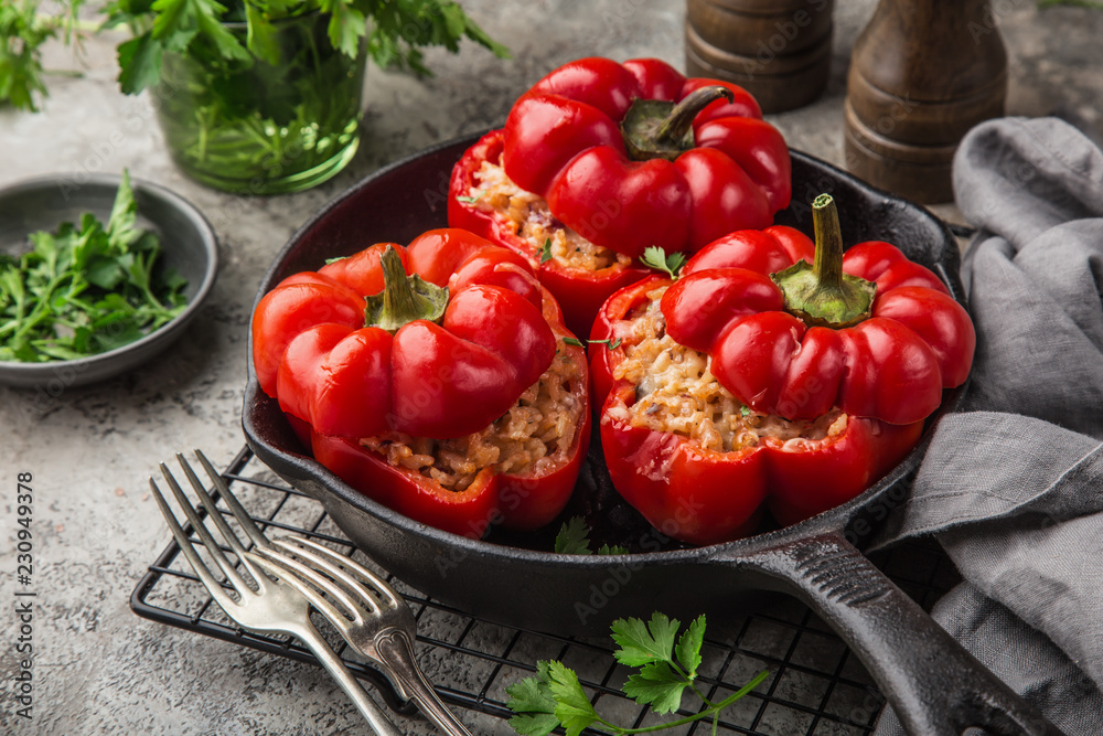 Fototapety, obrazy: red bell peppers stuffed with meat, rice and vegetables on cast iron pan