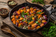 Roasted Pumpkin With Meat On Cast Iron Pan,  Rustic Backgroun