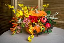 Bright Autumn Bouquet In A Pumpkin On Dark Background