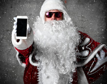 Santa Claus Show Blank Screen With Text Space Of Mobile Cellphone. New Year And Merry Christmas
