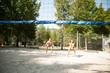 active young couple play beach volley on hot wimmer day