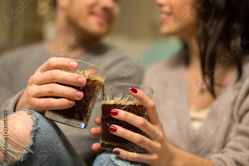 Canvas Print hygge, leisure and people concept - close up of happy couple drinking coffee at