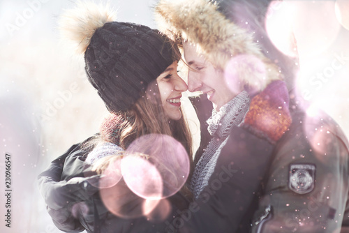 christmas happy couple in love embrace in snowy winter cold forest, copy space, Fototapet