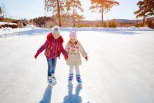 Happy Children Ice Skating On ...