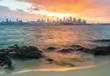 Sunset over Sydney Harbour, Australia. Sydney skyline and rocks foreground.