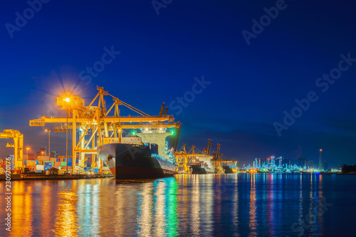 Foto op Plexiglas Xian Container cargo ship in the export and import business and logistics international goods in urban city. Shipping cargo to the harbor by crane at sunset.