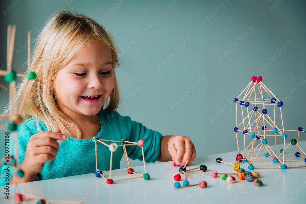 Fototapeta child making geometric shapes, engineering and STEM