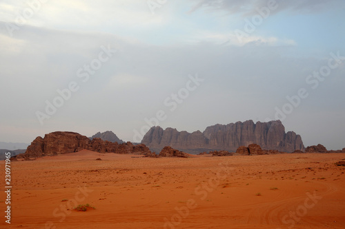 panoramic view of wadi rum desert lookin like mars planet with rocks and red sand