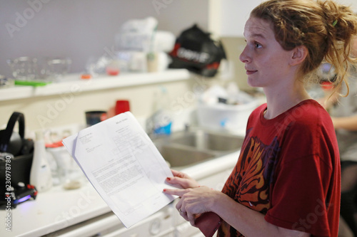 Marine wife Sharon Limon looks over documents in the kitchen of her