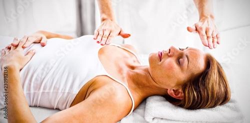 Fotografie, Obraz  Woman receiving reiki treatment