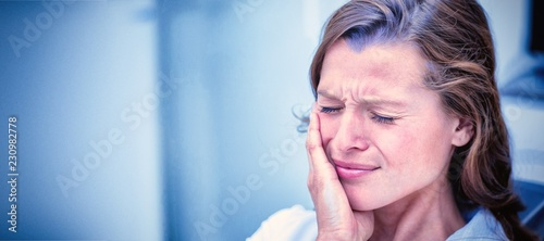 Stampa su Tela Unhappy woman having a toothache