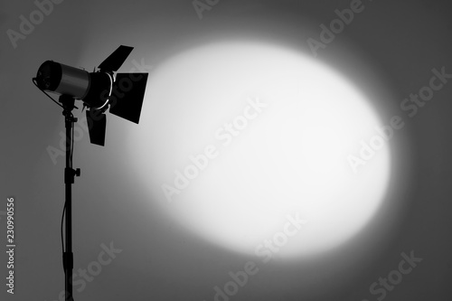 Fotografia, Obraz Ray of scenic spot light over dark background, stage illumination equipment