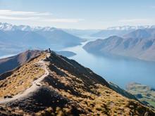 Hikers Enjoying The View From The Roys Peak Hiking Trail Near Wanaka, Otago, South Island, New Zealand