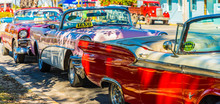 A Row Of Classic American Cars Used As Taxis In Varadero, Cuba