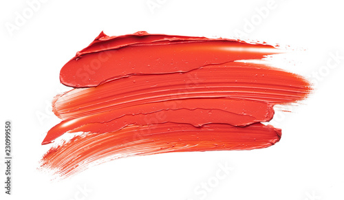 Smear and texture of red lipstick or acrylic paint isolated on white