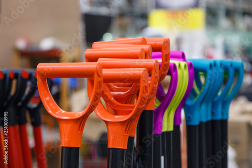 Colored plastic handle shovels in the store building tools. Concept repair of apartment or a country house, work in the garden and planting