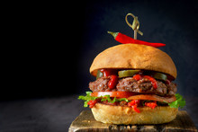 Spicy Burger With Chili On Dark Background