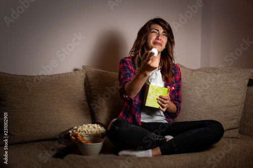 Photo Woman watching soap opera and crying