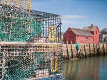 Lobster Traps With Red Fishing Shack In Background