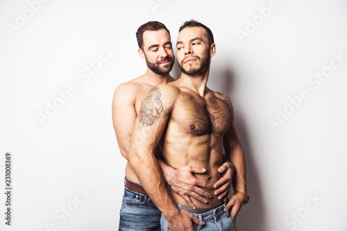 Young homosexuals gay couple love each other on a white background Canvas Print